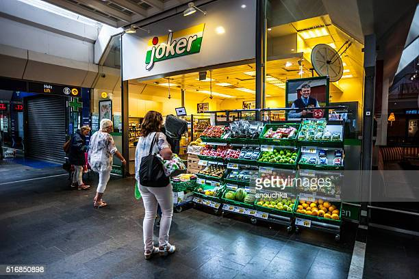 food store inside oslo train station, norway - convenience store interior stock photos and pictures
