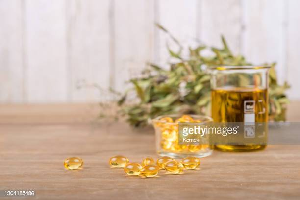 food supplement capsules with oil - omega 3, vitamin a or e - fatty acid stock pictures, royalty-free photos & images