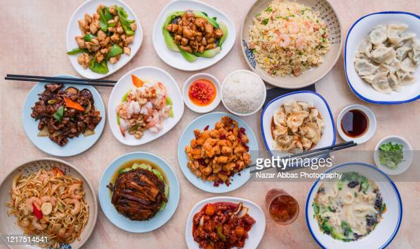 food table with chinese dishes. - nazar abbas photography stock pictures, royalty-free photos & images