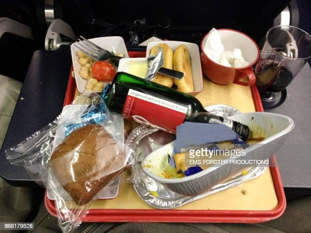food tablet with red wine bottle in airplane while flying