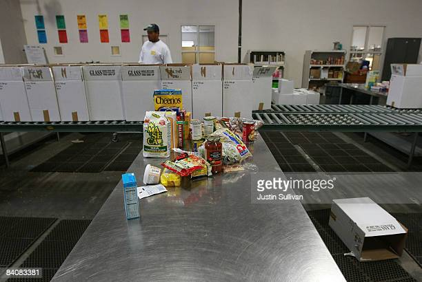 Food that will be packed into boxes for needy families is seen on a packing table at the Alameda County Community Food Bank December 18 2008 in...