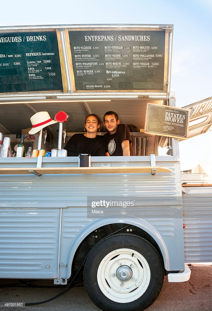 Food truck and owners : Stock Photo