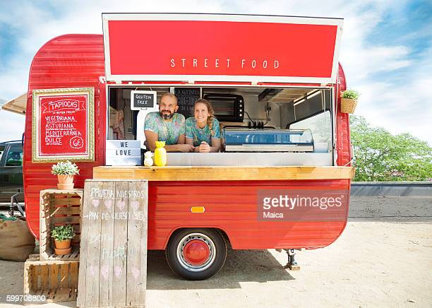 food truck and owners - vintage restaurant stock pictures, royalty-free photos & images