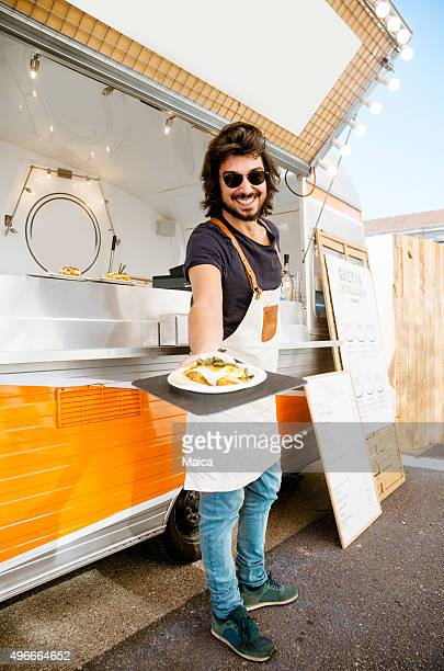 Food truck owner, happy