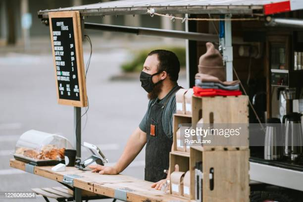 food truck owner wearing protective face mask - finance and economy stock pictures, royalty-free photos & images