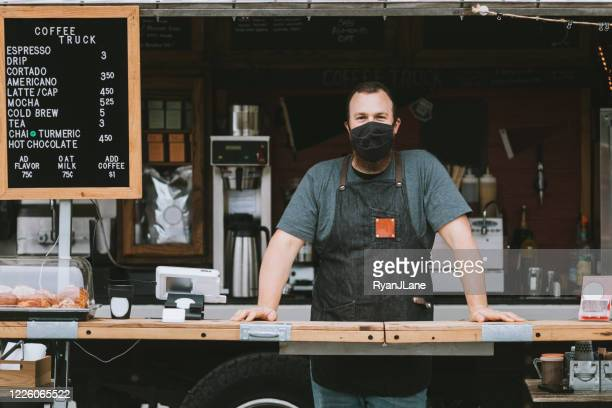 food truck owner wearing protective face mask - food truck stock pictures, royalty-free photos & images