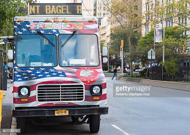 Food truck painted in American flag parked on a street in New York city USA Mobile food vending business requires a licence and have to follow strict...