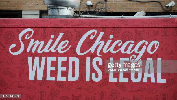 Food truck sits outside the Sunnyside Cannabis Dispensary as customers wait in line to buy marijuana, on January 1, 2020 in Chicago, Illinois. - On...