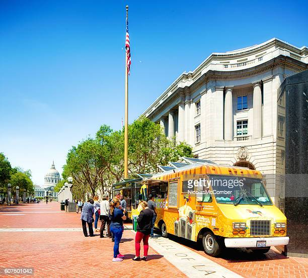 food trucks and customers at san francisco civic center - chicken and waffles stock photos and pictures