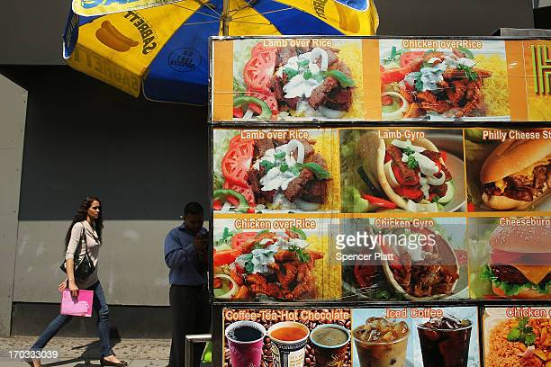 Food varieties are advertised outside of a food cart in a Brooklyn neighborhood with a high rate of obesity and diabetes on June 11 2013 in New York...