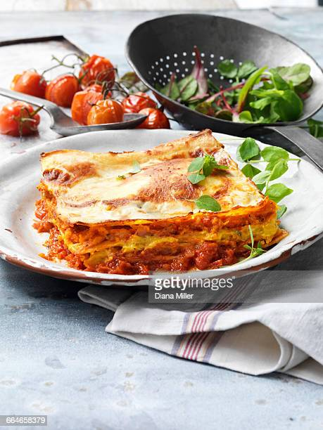 Food, vegetarian meals, roasted butternut squash lasagne, cheese, tomato, salad, vintage plate, rustic metal colander