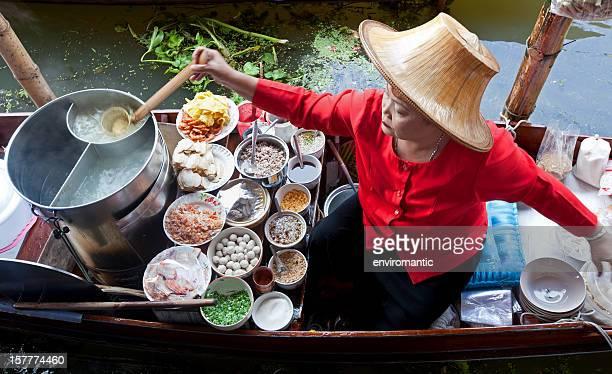 Food vendor at Damnoen Saduak Floating Market, Thailand.