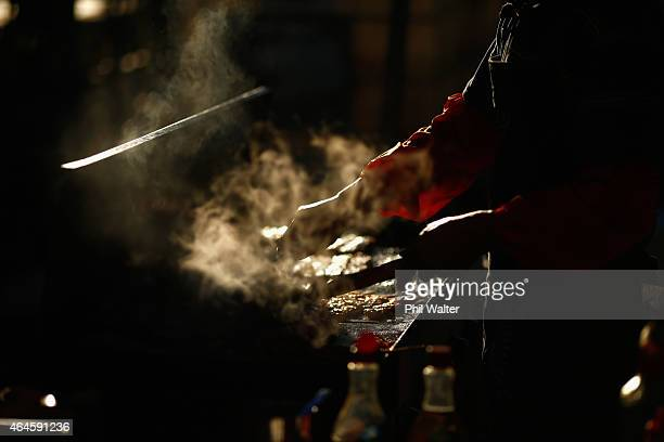 A food vendor at work cooking during the Lantern Festival in Albert Park on February 27 2015 in Auckland New Zealand New Zealanders attend the annual...