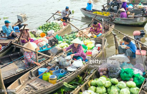 food vendor selling noodles on the boat - floating market stock photos and pictures