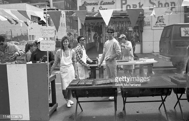 Food vendors prepare their grills outside the Giovanni Esposito Pork Shop in Hell's Kitchen during the International Food Festival New York New York...