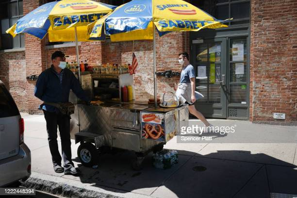Food vendors work on a spring afternoon on May 02, 2020 in the Brooklyn borough of New York City. New York City, which has been the hardest hit city...