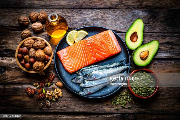 food with high content of healthy fats on rustic table. overhead view. - fatty acid stock pictures, royalty-free photos & images