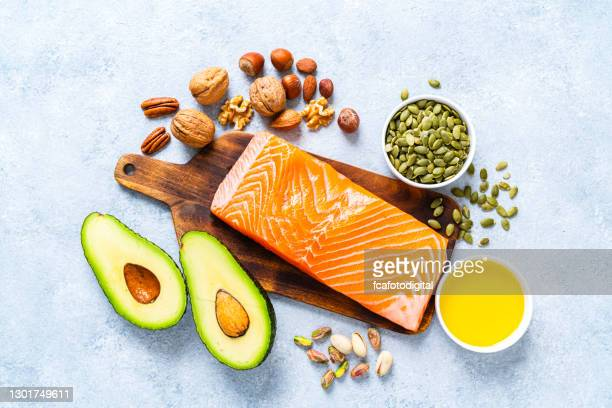 food with high content of healthy fats. overhead view. - fat nutrient stock pictures, royalty-free photos & images