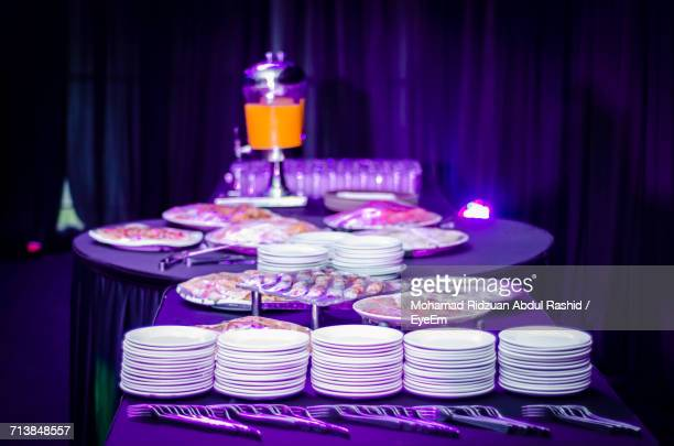Food With Stack Of Plates On Table In Restaurant