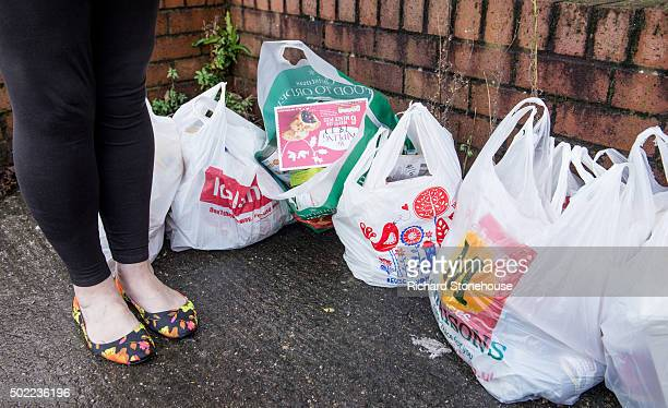 A foodbank client waits for a lift with her and another clients family food from the Trussell Trust Food Bank In Liverpool on December 21 2015 in...