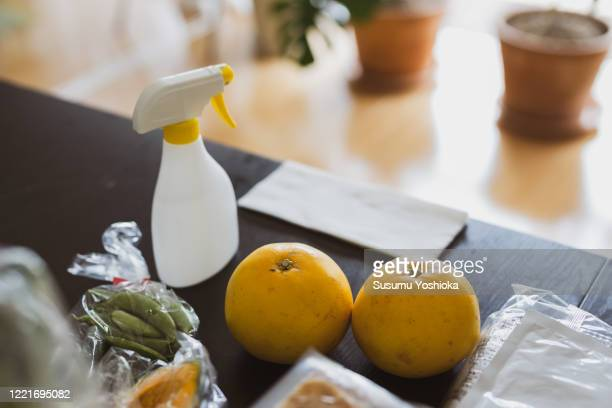 foods and disinfectant on the desk - 消毒薬 ストックフォトと画像