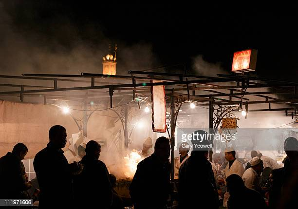 foodstalls at night in djemma el fna - yeowell stock pictures, royalty-free photos & images