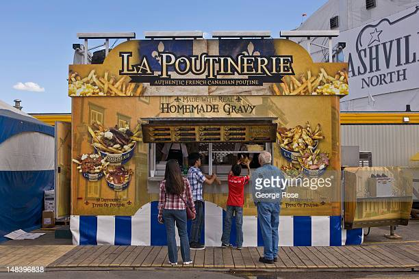 A foodstand featuring classic FrenchCanadian poutine is viewed on July 5 2012 in Calgary Canada Calgary Stampede the world's largest outdoor event...
