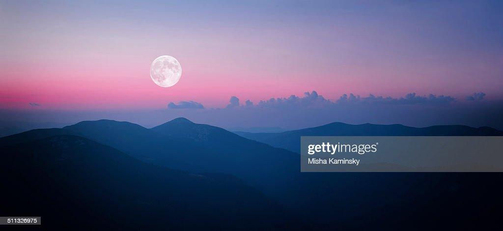 Fool moon rising over the mountain range : Stock Photo