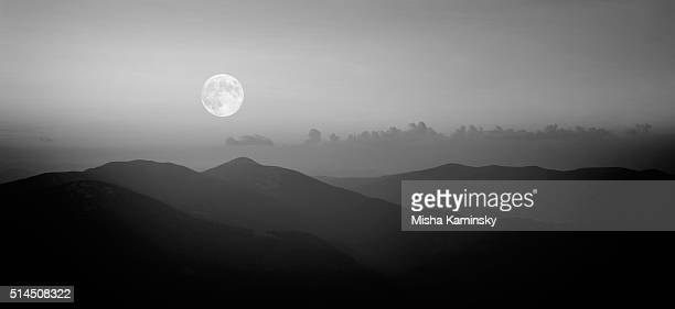 Fool moon rising over the mountain range