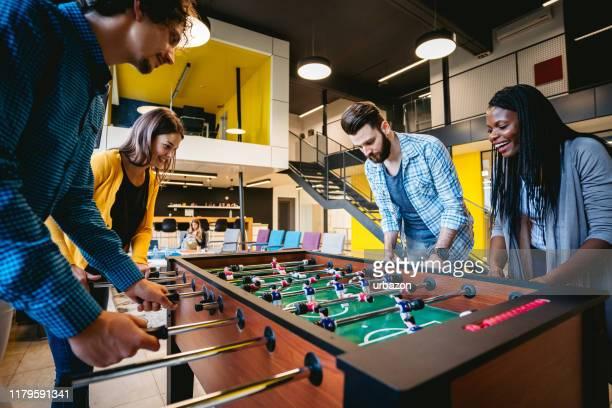 foosball break - friendly match stock-fotos und bilder
