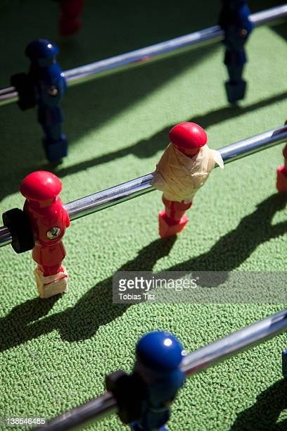 A foosball game player repaired with masking tape