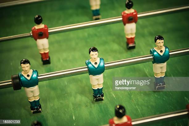 foosball game, red and blue player - sport leisure theme - passing sport stock pictures, royalty-free photos & images