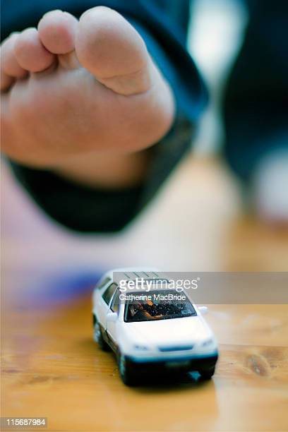 foot about to step on car with person inside - catherine macbride stockfoto's en -beelden