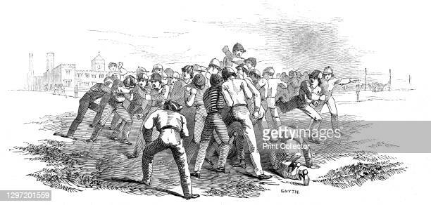 Foot Ball at Rugby, 1845. Schoolboys playing rugby football at the public school where the game was invented in about 1845, although forms of...