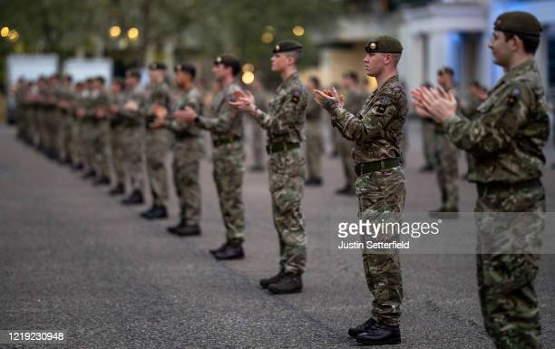 Foot Guards of the Household Division clap for the NHS workers at Wellington Barracks in Westminster on April 16 2020 in London United Kingdom...