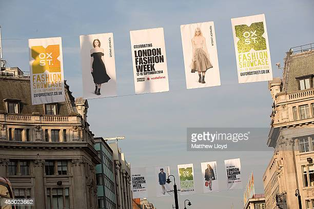 12 foot high fashion flags featuring catwalk shots from top designers decorate 15 miles of Oxford Street for it's Fashion Showcase on September 9...