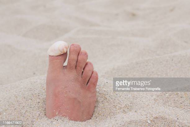 Foot in the sand
