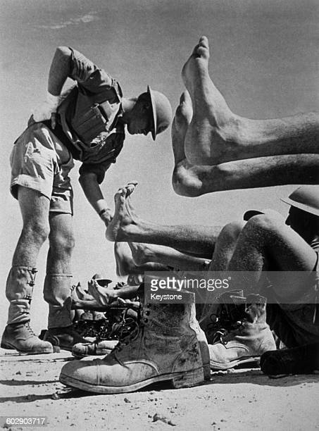 A foot inspection for British soldiers of the 7th Armoured Division in North Africa during World War II circa 1941 Desert warfare necessitated long...