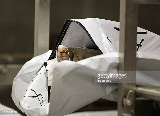 A foot is seen in an open body bag in a refrigerated room at the Wayne County Medical Examiner's office in Detroit Michigan US on Wednesday Sept 7...