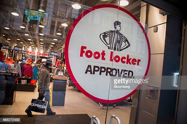 Foot Locker Inc signage is displayed in the window of a store in New York US on Wednesday March 4 2015 Foot Locker Inc is scheduled to release...