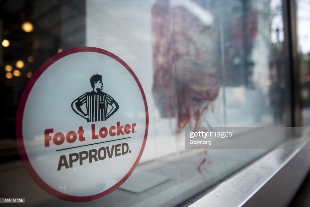 Foot Locker Inc. signage is displayed on the window of a store in downtown Chicago, Illinois, U.S., on Sunday, May 13, 2018. Foot Locker Inc. is scheduled to release earnings figures on May 25. Photographer: Christopher Dilts/Bloomberg via Getty Images