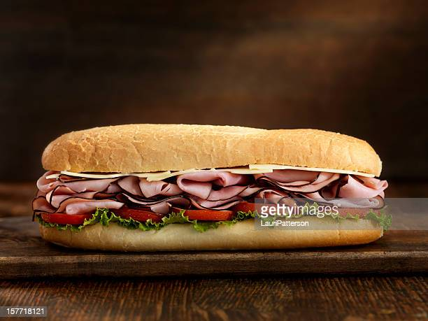 foot long ham and swiss cheese sub - baguette stock pictures, royalty-free photos & images