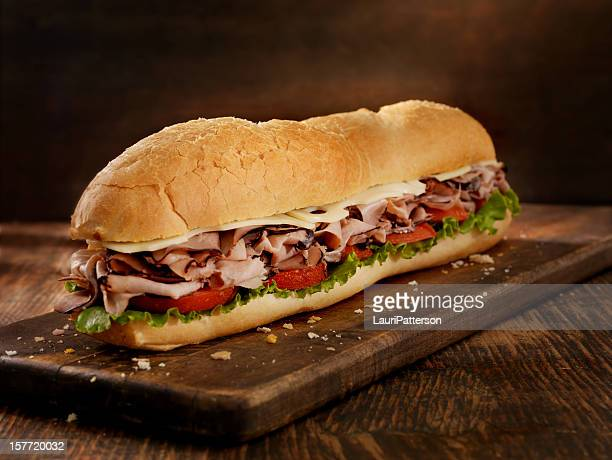 foot long roast beef and cheese sub - submarine stock pictures, royalty-free photos & images