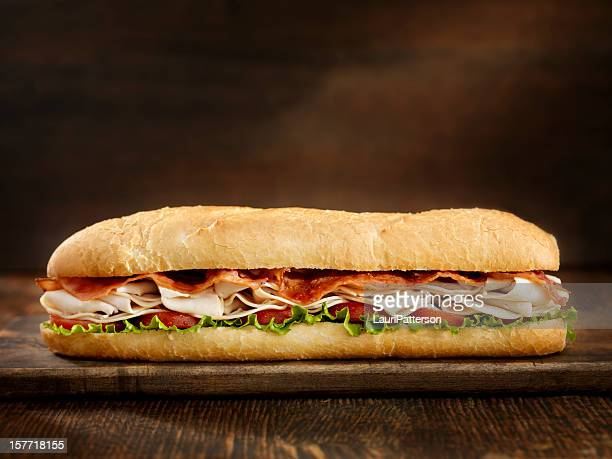 foot long turkey and bacon sub - baguette stock pictures, royalty-free photos & images