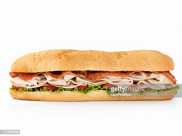 foot long turkey club submarine sandwich - bun stock pictures, royalty-free photos & images