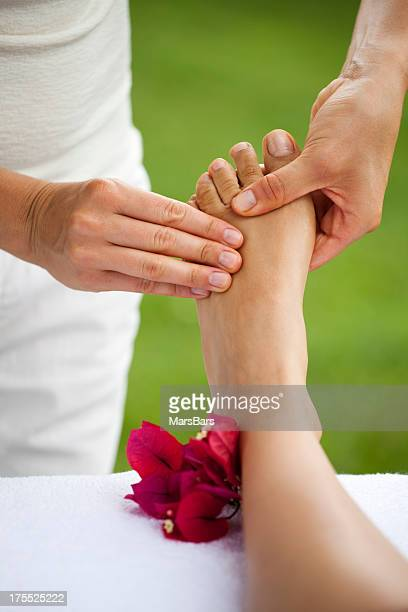 foot massage at spa - foot massage stock pictures, royalty-free photos & images