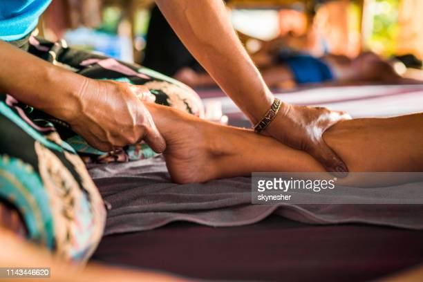 foot massage at the spa! - reflexology stock pictures, royalty-free photos & images