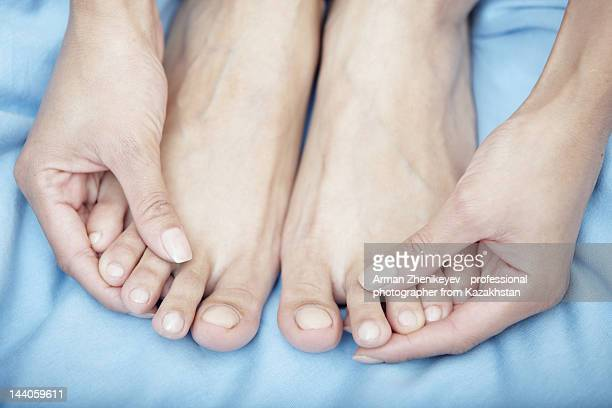 foot massage - pretty asian feet stock photos and pictures