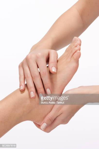 foot massage - foot massage stock photos and pictures