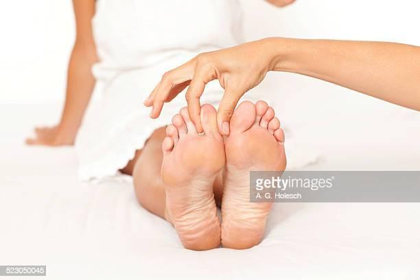 Foot massage, womans feet being massaged